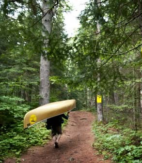 Algonquin-Park-Portager-With-Portage-Signs